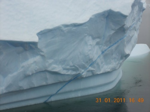 An iceburg with a distinctive blue line across it.