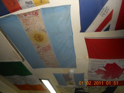 More signed flags of various countries.