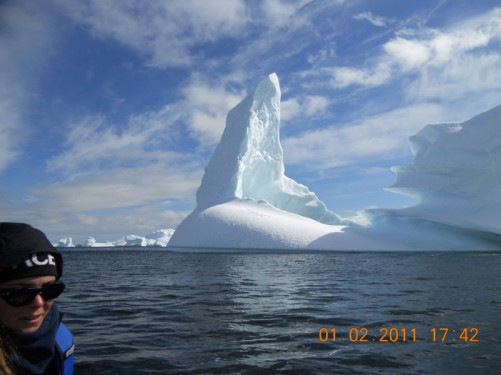 An enormous towering pinnacle of ice, part of the same iceberg.