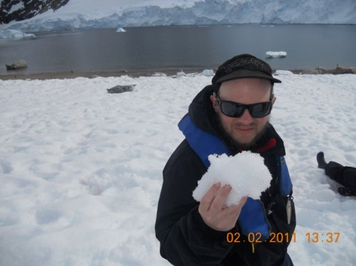 Tony holding a lump of snow.