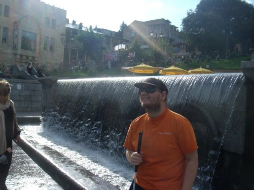 Tony by a fountain in Rustaveli Square.