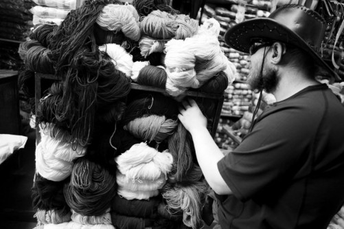 Tony feeling wool in Tupiza market.