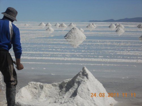 Men working on the salt flats, Uyuni, Bolivia.
