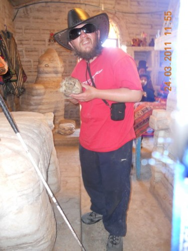 Tony holding an Armadillo in the salt museum.