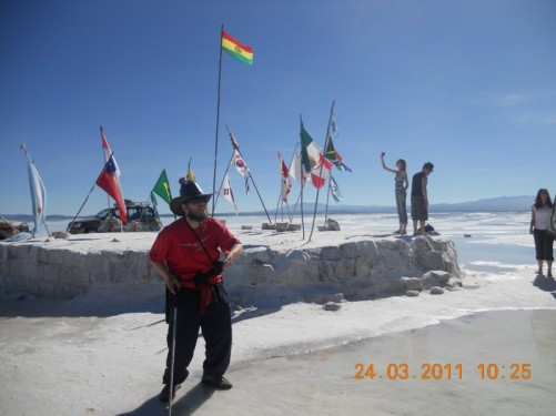 Tony stood by the National Flags from around the world at Solar de Uyuni.
