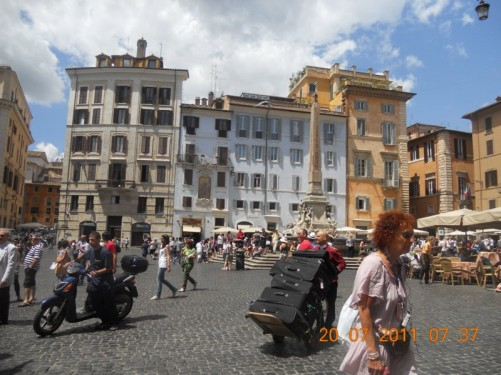 Piazza della Rotonda, a rectangular square with central fountain and obelisk in front of the Pantheon.