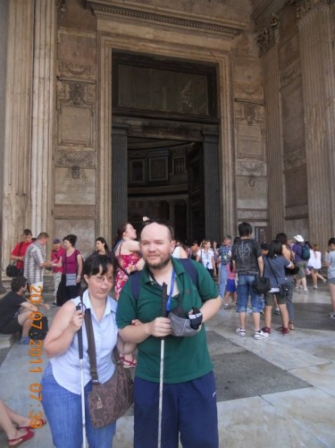 Tony and Tatiana in front of the large bronze doors at the Pantheon's entrance.