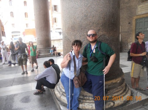 Tony and Tatiana in front of a stone column outside the Pantheon.