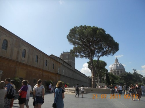 Terrace area of the Vatican Museum. St. Peter's dome of St. Peter's Basilica in near distance.