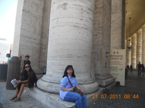 Tatiana sitting at the foot of a column in St. Peter's Square.
