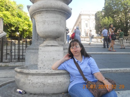 Tatiana sitting at the bottom of the steps leading to Piazza di Campidoglio.