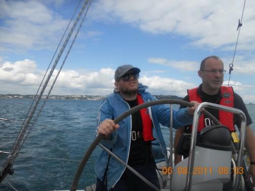 Tony steering the boat.