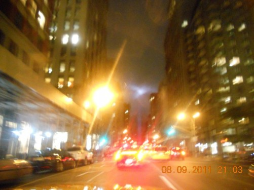View of downtown Manhattan at night, taken from a moving car.
