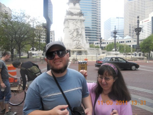 Tony, Tatiana in downtown Indianapolis, Chase Tower and the Soldiers and Sailors Monument in the background.