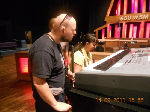 Tony, Tatiana examining a musical keyboard.