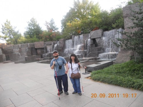 Tony, Tatiana in front of a series of waterfalls.