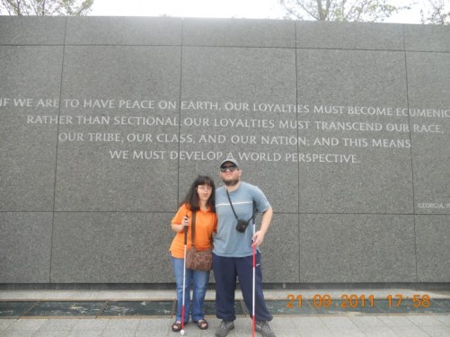 Tony, Tatiana in front of the inscription wall.