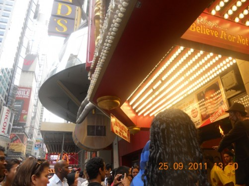 Crowd of people outside 'Ripley's Believe It or Not' Times Square Odditorium.