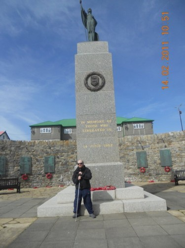 Tony stood by the stone 1982 Falkland War Memorial, on the hill overlooking Stanley.