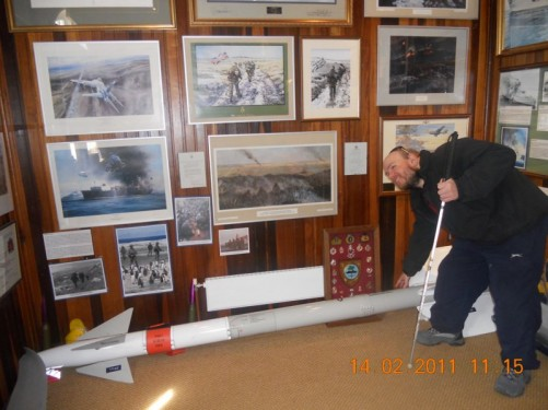 Inside the Falkland Islands Museum and National Trust at Britannia House. Tony touching a missile.