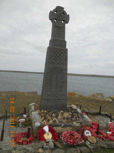 Memorial dedicated to members of the First Battalion Welsh Guards killed in an Argentine air attack at Fitzroy/Bluff Cove during the Falkland Islands War (2nd April-14th June 1982).
