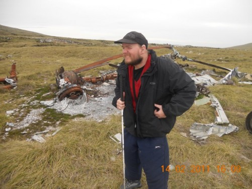 Tony by the remains of an Argentine Puma Helicopter that was shot down by the British SAS special forces during the conflict, located in the vicinity of Mount Kent near Stanley.