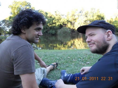 Tony and Rodrigo, sat on the grass in Palermo Park.