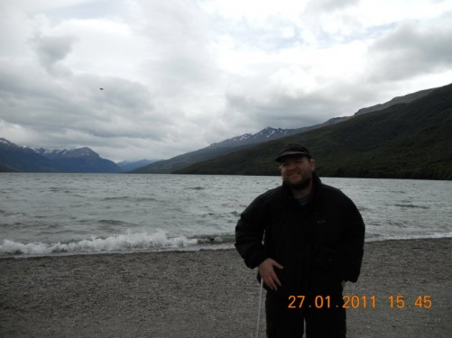 Tony stood on a beach in Tierra del Fuego National Park, snow capped Martial Mountains in the far distance.