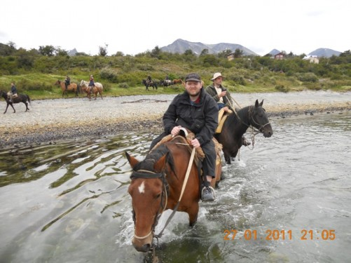 Tony riding a horse in the Beagle Channel.