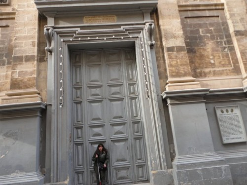 Tatiana standing in the very tall doorway of St Francis of Assisi Church. Located on Republic Street. Building work started in 1598 and it was completed by 1607.