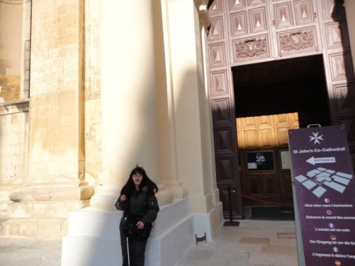 Tatiana outside the entrance to St John's Co-Cathedral.