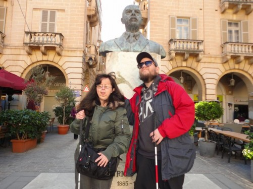 Tony and Tatiana in front of a bust of former Maltese Prime Minister Enrico Mizzi, sculpted in 1964 by Vincent Apap. Located in the centre of St John's Square.