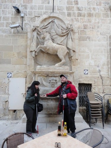 Tony and Tatiana touching the unicorn fountain in St John's Square. Sculpted by Mariano Gerada in 1820.