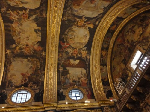 Looking up at the richly decorated ceiling, painted by Mattia Preti.