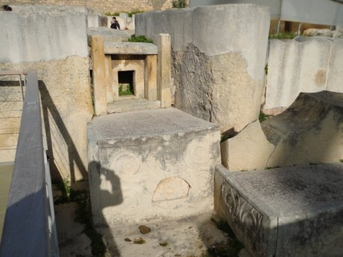 A room within the Tarxien temples site, including stone carved with a spiral pattern. The site contains the remains of four Neolithic temples that were uncovered by local farmers in 1913-14. They date from between 3600 and 2500 BC.