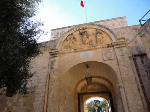 Looking up at carvings above the Main Gate into Mdina.