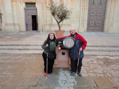 Tony and Tatiana beside a canon outside the Cathedral of St Paul.