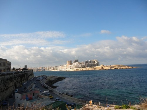 View from Valletta across Marsamxett Harbour to Sliema. Construction of a large residential and retail development at Tigne Point can be seen.