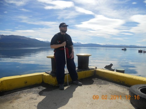 Tony standing at the small harbour of Puerto Navarino in the western part of Navarino Island, with a nice view across the Beagle Channel.