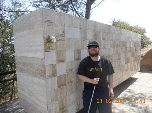 Tony by a stone memorial in Parque Metropolitano.