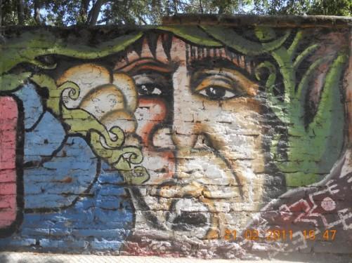 More interesting graffiti artwork on a wall.