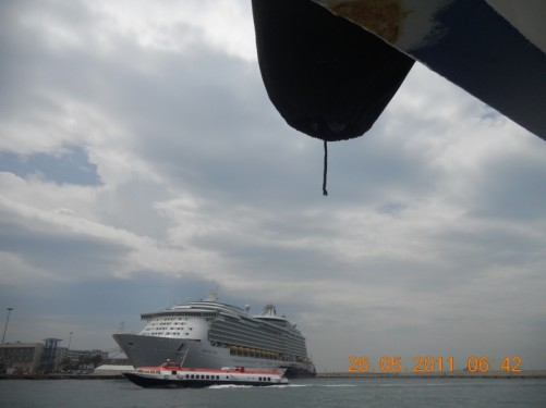 Passing a large cruise ship in Piraeus port.