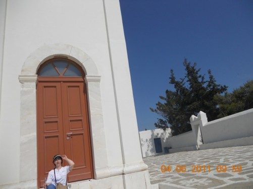 Tatiana sitting outside Naoussa church.