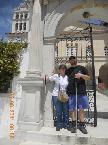 Tony and Tatiana at a gateway leading up to Agia Triada church.