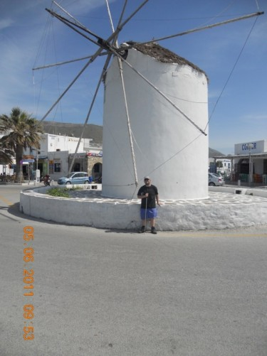 Back in Parikia. Tony in front of the historic windmill.
