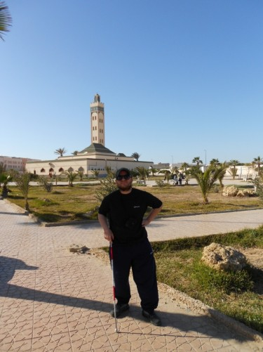 Tony in Dakhla Square with a mosque at the far side.