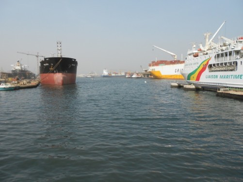 Dakar port. Large ships with cargo being loaded and unloaded.
