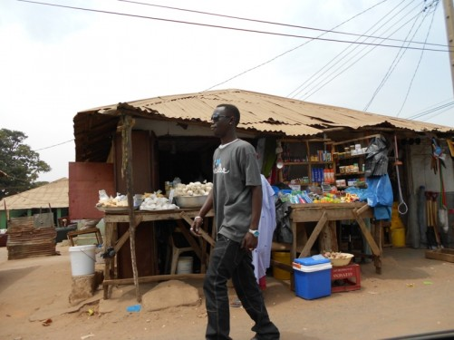 A roadside stall selling toiletries and other goods, part of Serrakunda market – the largest market in the Gambia.
