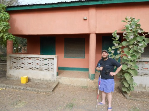Tony outside Kairoh Garden Guesthouse, Kuntaur Village, on the north bank of the Gambia River.