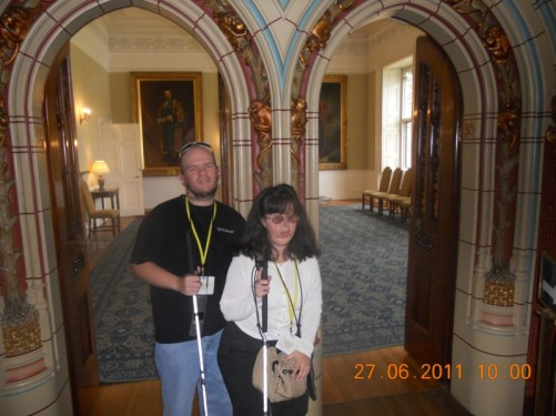 State rooms. Tony and Tatiana at a doorway.